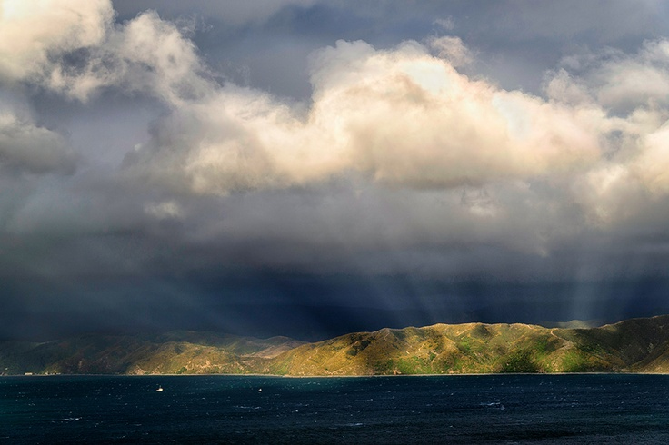Clouds and light rays over Wellington Harbour, New Zealand.
