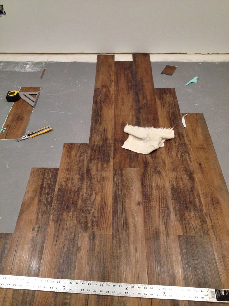 Installing peel and stick laminate floors in a basement for How to install wood flooring