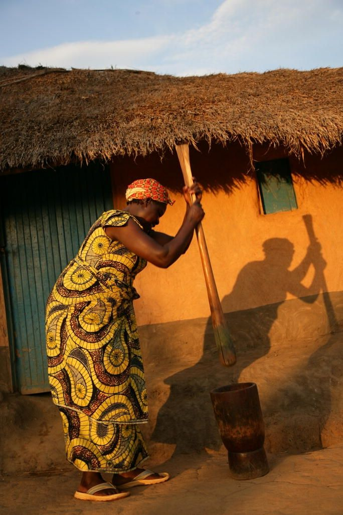 Authentic Africa | Congolese Woman  pounds manioc (cassava) leaves in preparation of a coo..., ,