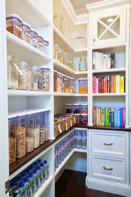 I think I would move the cabinet flush w/shelves on the left and run a narrow group of shelves (5-6in) all along wall on the right for single can depth storage.