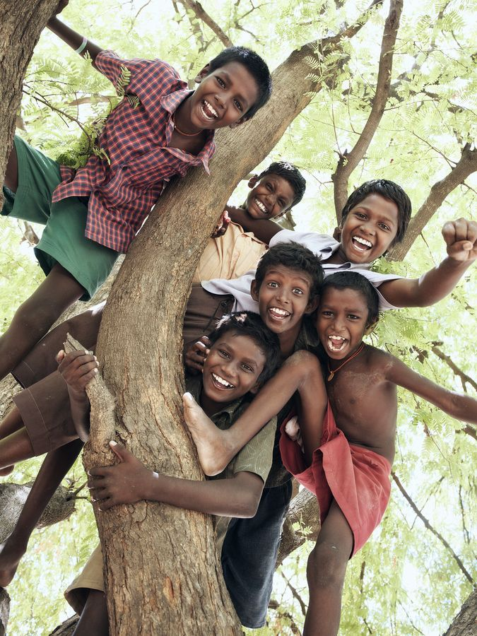 joyful youth in India When was the last time you saw so many children enjoying the simple pleasure of climbing a tree in your neighborhood? Some things, money can't buy.