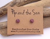 Delicate copper leaf flakes embedded in faceted purple grape eco-resin spheres on allergy-friendly studs