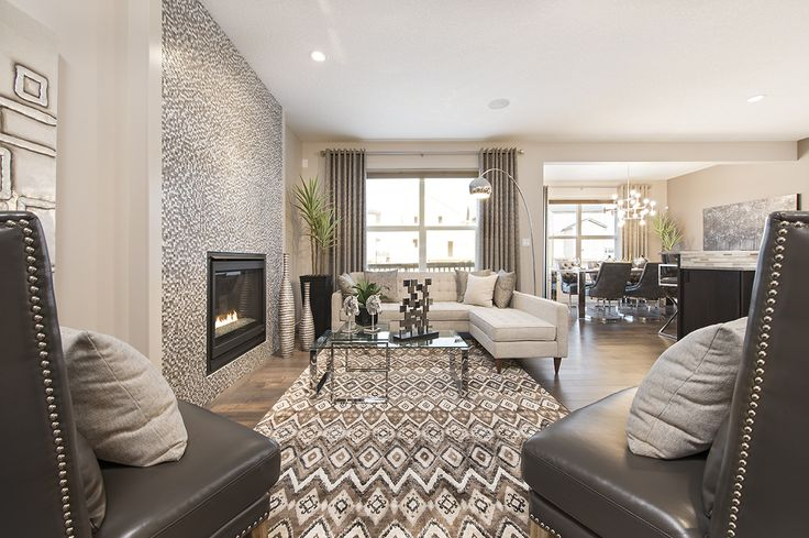 Make your fireplace the focal point of your living room by accenting it with a full height tile surround,<br></a>as seen in this Jayman MasterBUILT Allure showhome in Secord, Edmonton. A patterned rug in similar<br/>tones accents the surround, making this living area an energetic center to your whole house.