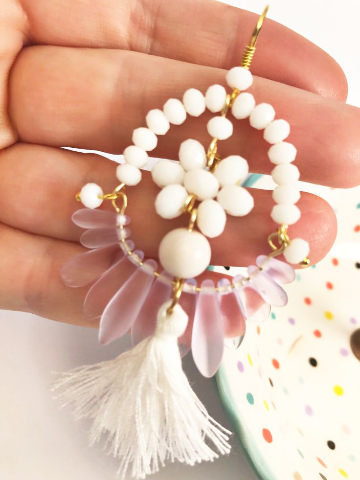White Tassel Earrings from Printemps Été new collection. Available NOW from Etsy shop. Link: etsy.com/shop/printempsete Worldwide shipping only $9AUD  White Coral, faceted crystals and bohemian crystals, a pleasure for your ears, on gold plated ear hooks. So bohemian ❤️