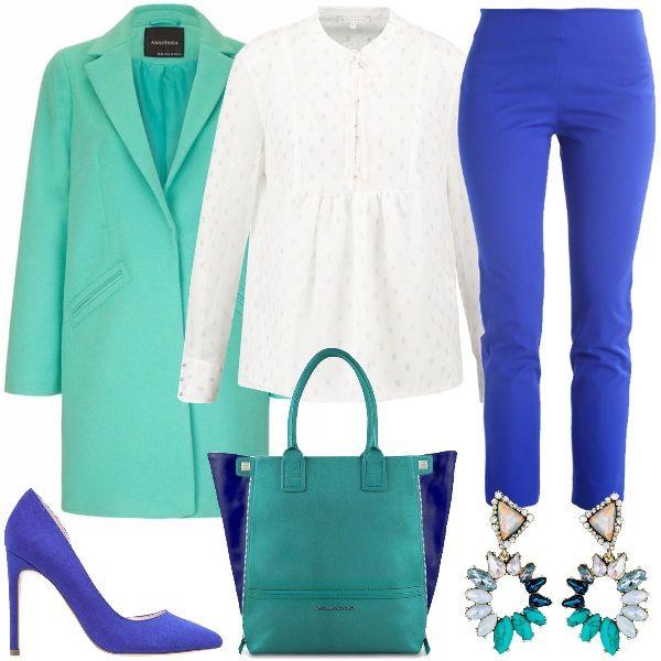 Outfit chic, ricco di colore per chi, anche d'inverno, non vuole farselo mancare. Il look è composto dal pantalone blu in una tonalità brillante, abbinato alla blusa bianca, il cappotto verde acqua, come la borsa a mano con i lati blu. Completano le décolleté blu e gli orecchini pendenti che riprendono tutti i colori del look.