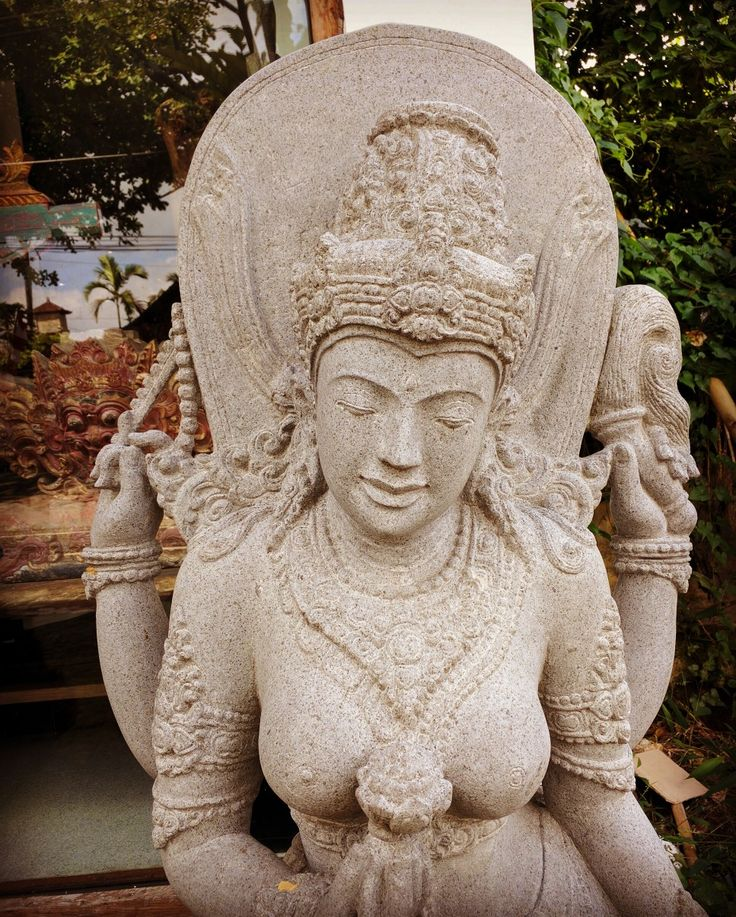 Balinese Hindu Goddess Dewi Tara in front of Kuluk Gallery. So lovely and carved from solid black stone by master carvers. www.kulukgallery.com  #Balistonecarvings #balistone #ubud Please come and visit us in Ubud.