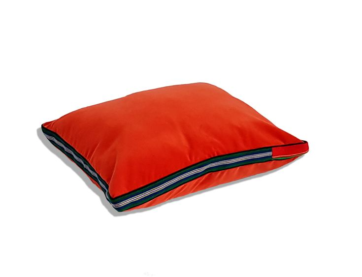 Velvet red pillow with regional addition of hand woven fabric