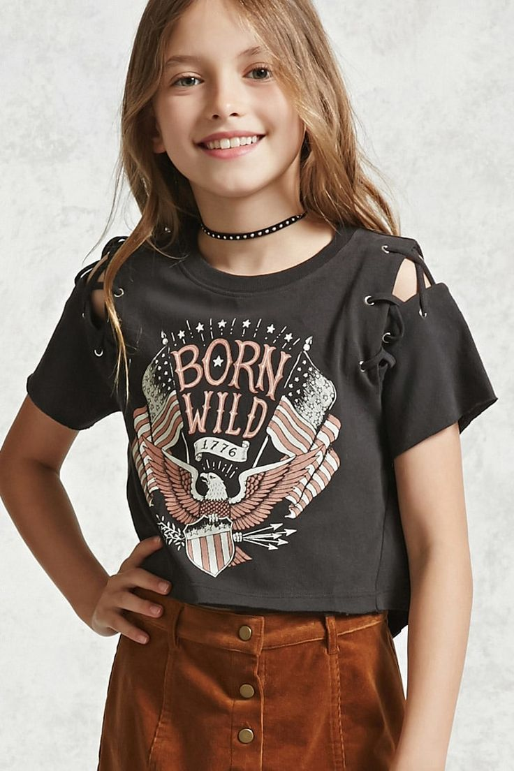"""Forever 21 Girls - A knit tee featuring front """"Born Wild"""", """"1776"""", and eagle graphics, a ribbed crew neck, split short sleeves with a crisscross lace-up design, grommets, asymmetrical seam construction, a high-low hem, and raw-cut trim."""
