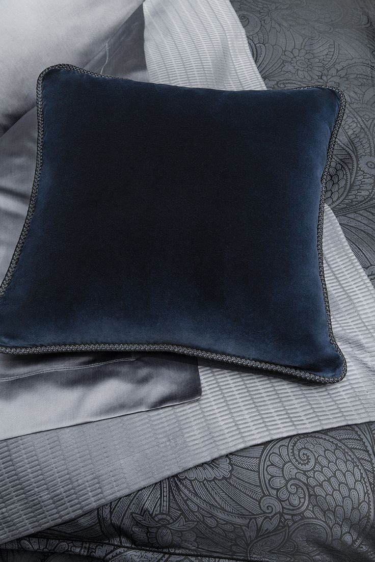 Snuggle in atop the bed or sofa with this soft all-cotton velvet rendered in a beautiful, mysterious hue and seamed with an elegant braided trim.