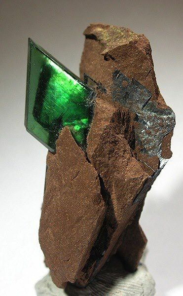 Vivianite... Vivianite is a well-known phosphate mineral, forming in highly aesthetic sharply colored crystals. Vivianite is named in honor of John Henry Vivian, an English mineralogist and mine owner who first discovered this mineral in Cornwall.Chemical formula Fe3(PO4)2 · 8(H2O)