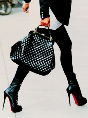 Classic black with a few pricey, fad pieces.  Louis Vuitton handbag and louboutin booties all in winter black