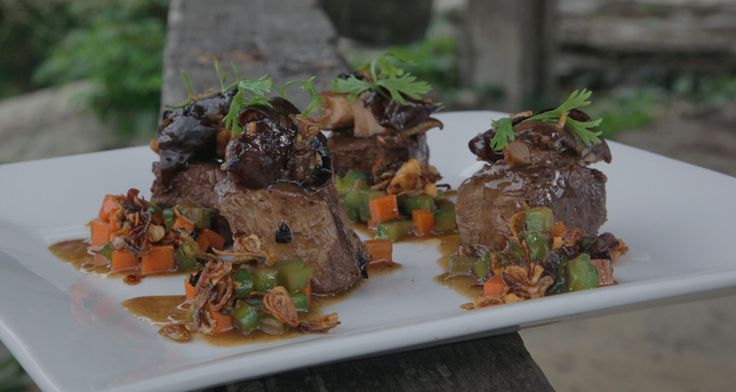 Beef with Sautéed Mushrooms and Ampalaya: http://gustotv.com/recipes/lunch/beef-sauteed-mushrooms-bitter-melon/