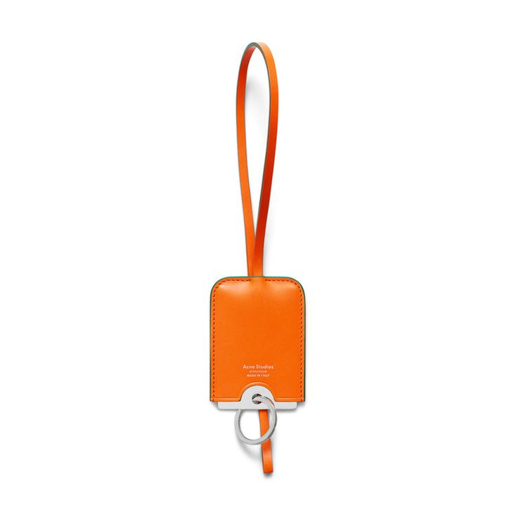 Acne Studios Cinn orange is a combination mirror, keychain, and necklace that is both functional and unique.