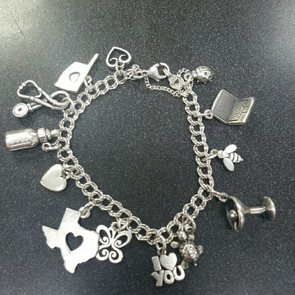 James avery bracelet James avery bracelet  with 13 charms 2 retired bottel & laptop  strong stamps bracelet is a light double curb size medium 7 inch James Avery Jewelry Bracelets