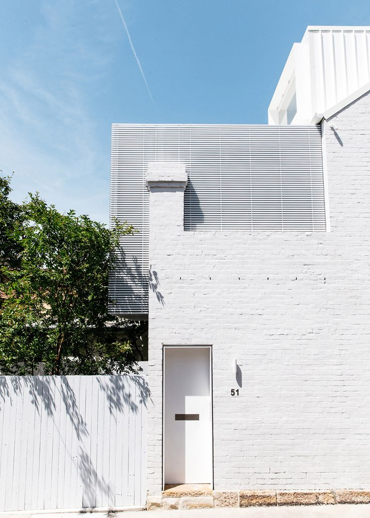 CM Studio added a timber batten-clad box and a steel dormer window to the rear elevation to provide extra space, and painted both structures to match the original structure's white brickwork.