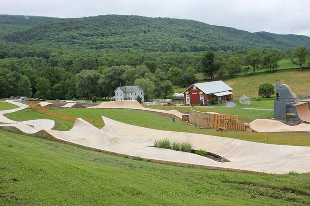 Pennsylvania's Camp Woodward is home to this new snake run designed to mimic the sloping school yards and dried concrete waterways of Southern Califorinia, where skateboarding's roots reach deepest. The snake run is the most fundamental form of all skatepark designs. Designed by California Skateparks.