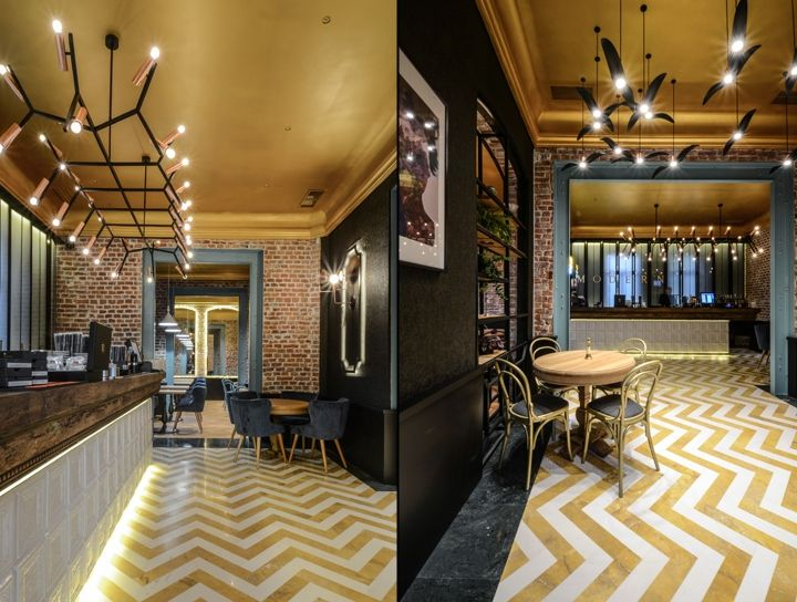 Like on the inferior register – the marble flooring in the zigzag or the oak flooring – the furniture that supports the retro look is placed, as well the golden lighting pendants preserves the luxurious aspect of the ceiling. The eclectic atmosphere derives precisely from this arrangement of the two mirrored registers, as two entities trying to grow towards each other, and whose contrast is melted in a neutral median layer.