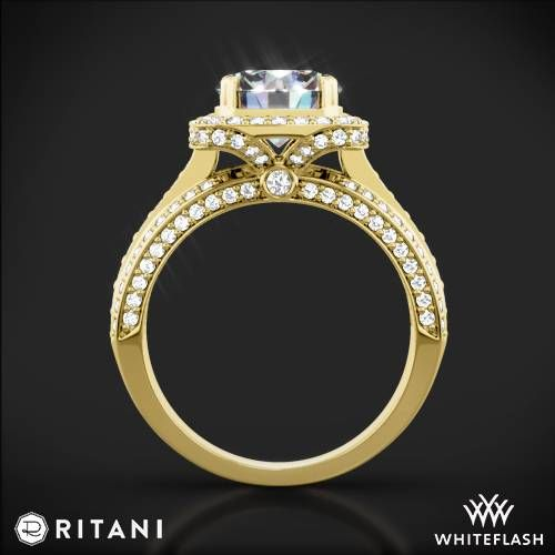 The beauty of this Ritani Masterwork diamond engagement ring is made uniquely intriguing by three bands of sparkling pavé diamonds. Look to the details and you'll notice brilliant pavé diamonds sparkling along the sides and beneath the setting -- stunningly beautiful from every angle. The setting features a brilliant cushion-shaped pavé diamond halo accented with bezel-set surprise diamonds. With every look, its brilliance reminds her of you. For information and pricing on additional center…