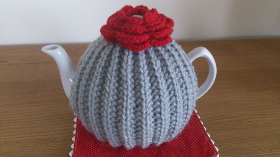 Grey/Red hand knitted tea cosy with a crochet flower by DottyKnits