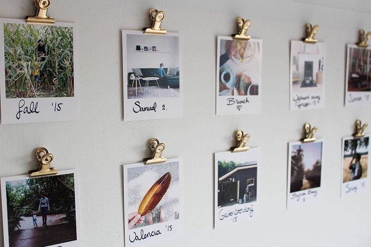 Spray paint bulldog clips and attach them to the wall with sticky tack to create a gallery wall with Polaroids.
