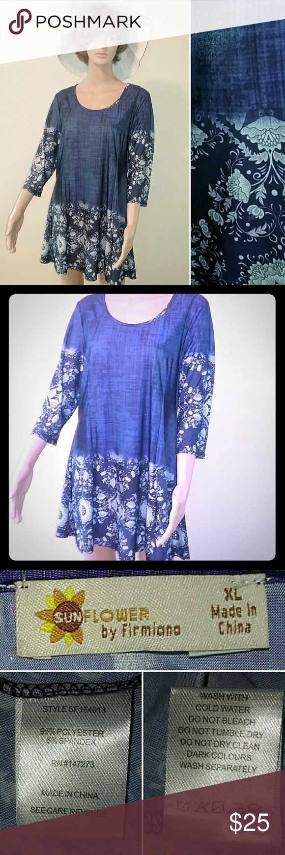 Boho Tunic in China Blue Comfort meets style in this fashionable long tunic top with scoop neck, 3/4 sleeves, and mixed floral and faux denim patterns. This item is pre-owned, gently used, and in excellent condition. Sunflower by Firmiana Tops Tunics