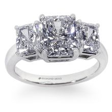 Custom Three Stone Radiant Engagment Ring: This extraordinary three-stone radiant engagement ring features a 2ct center stone, flanked by 1.5ctTW of smaller radiants.  They are prong-set in a basket head. All custom rings are created around the stone of your choice and priced individually.