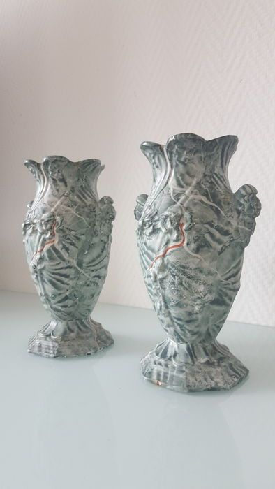 A pair of green marbled garden vases of cast iron – France – first half 20th century