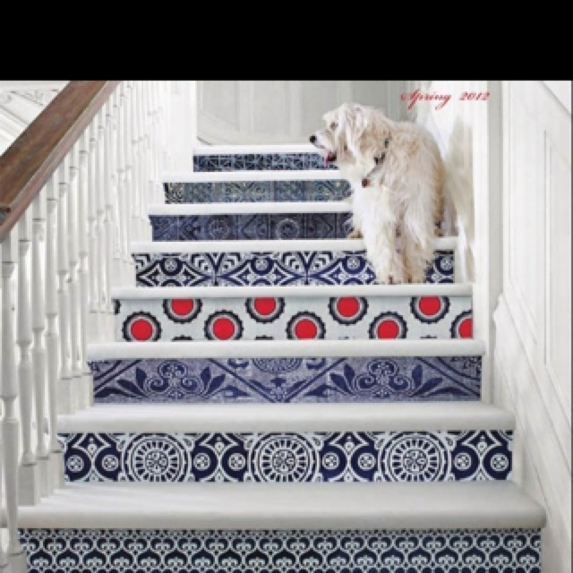 like the color of the tiles under the stairs.
