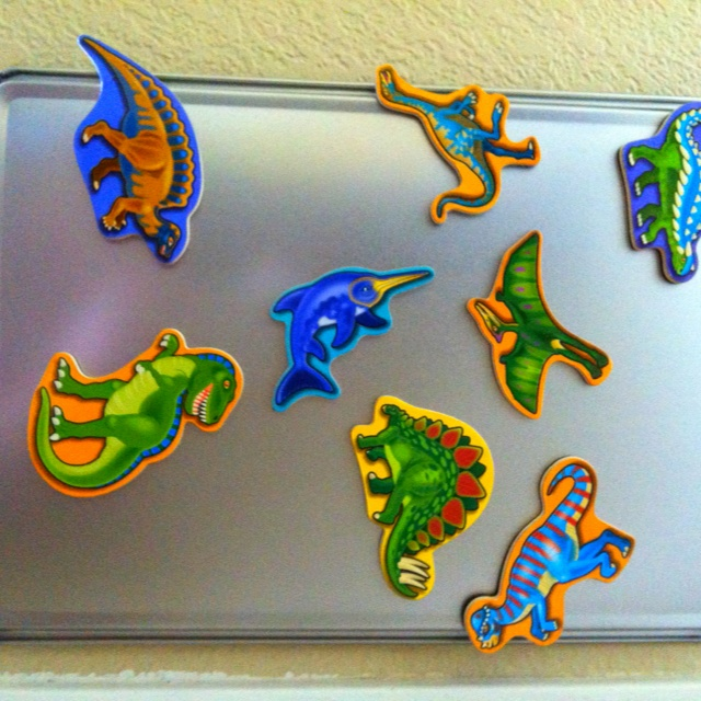 Infant or Toddler Activity - Hang dollar store cookie sheets with command hooks or Velcro, you've got an instant magnet board. Use color, shape, different size magnets