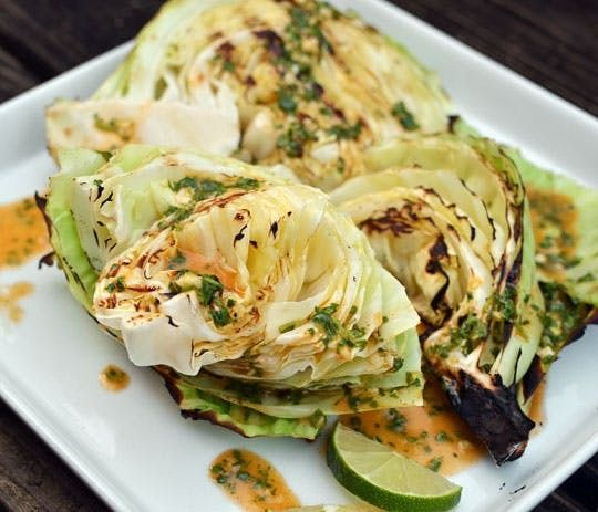 Grilled Cabbage Wedges with Spicy Lime Dressing. This recipe serves you healthy greens for vegan and vegetarians alike as a delicious Autum side dish. Added to this side is a spicy lime dressing for some fire to the taste. To make this side dish, you'll need 1 head green cabbage, extra virgin olive oil, and lime juice.