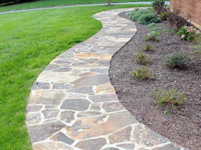 Stone walkway, this would fit the house perfectly