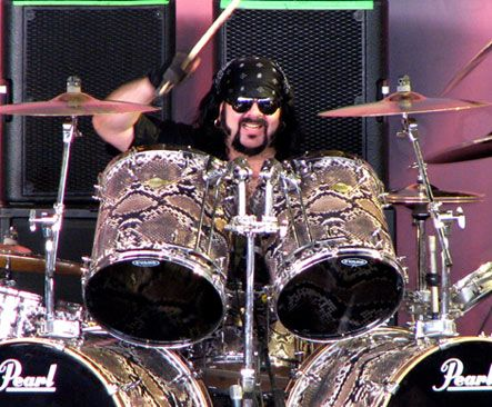 Vinnie Paul his sound is unmistakable those drums just sound like mortars and machine gun fire.....in a very swinging way