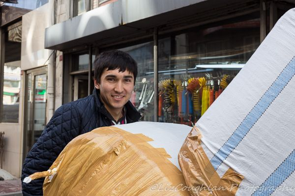 Young Man Transporting Packages, in Aksaray, Istanbul