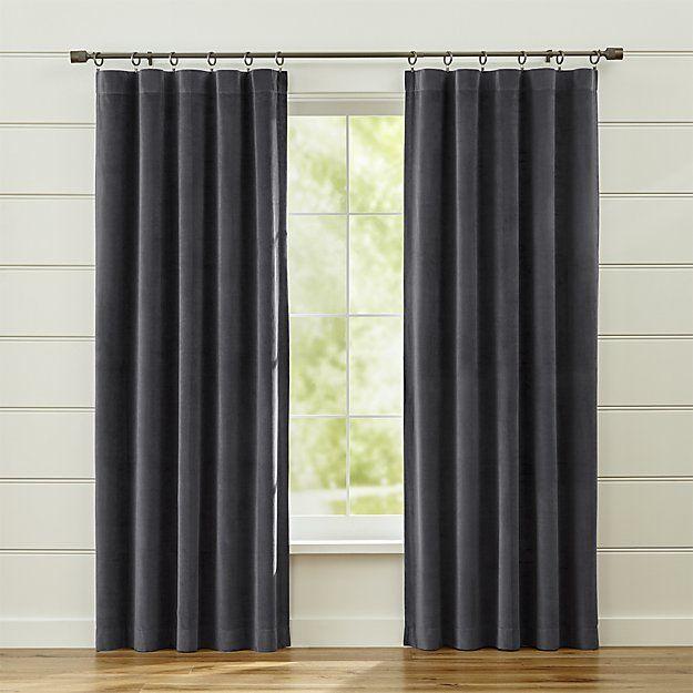 luxurious dark grey velvet curtain panels frame windows in a lush plush neutral made