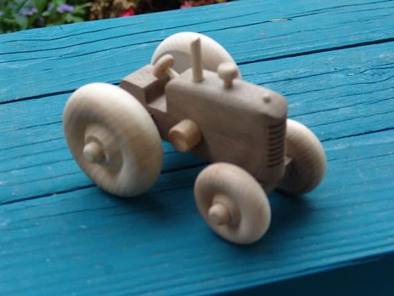 Small farm tractor with plenty of detail made from walnut.