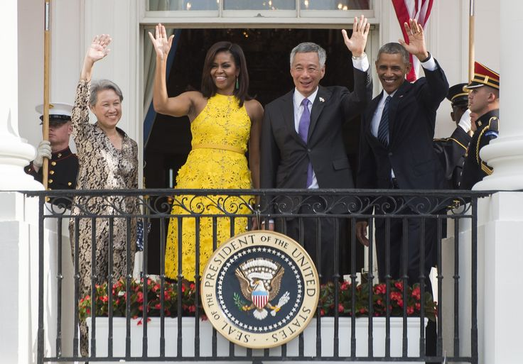 First Lady Michelle Obama in Naeem Khan yellow dress. August 2, 2016