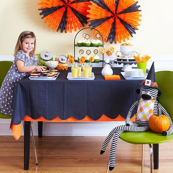 I like the table-cloth.  Solid orange tablecloth with black  tablecloth on top cut with scallops.