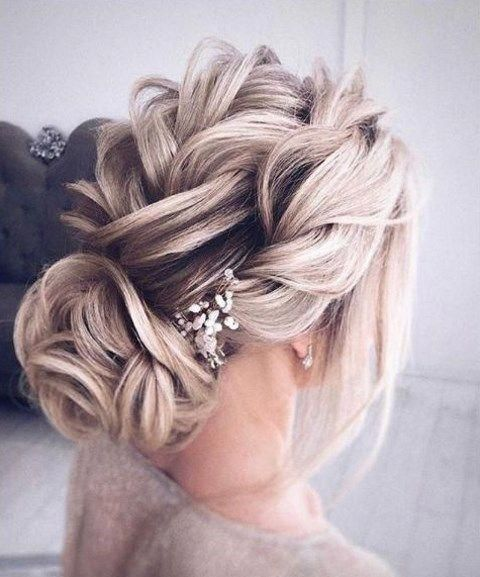 A low bun is a classic hairstyle, which is popular for many occasions and especially for weddings. What about rocking a low bun at your wedding? There are ...