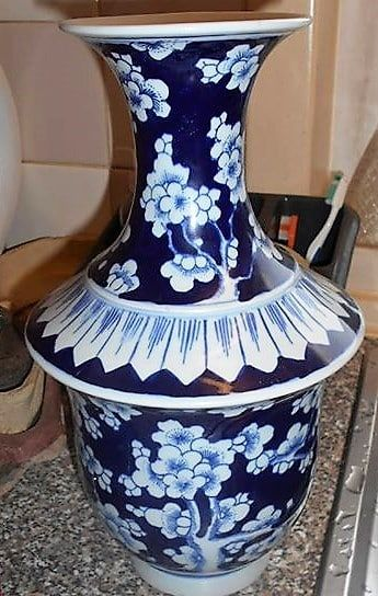 Lovely, unusual shaped Chinese vase  It is blue and white with prunus flowers  The vase is signed  The condition is fantastic, no chips, cracks or restora