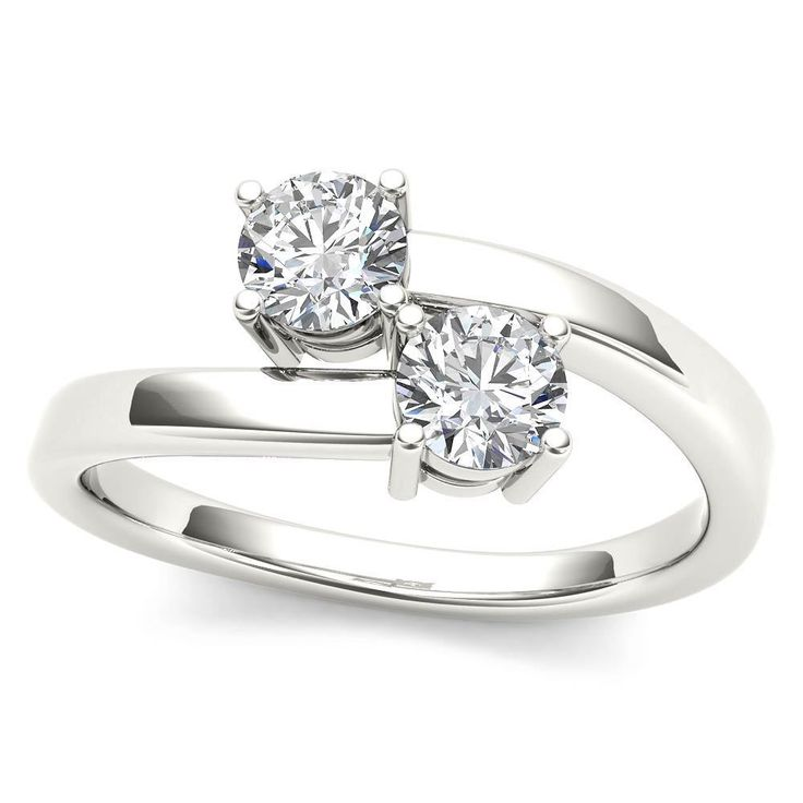 Made in white gold, this exquisite design features two diamonds, representing both your friendship and loving commitment. The polished bypassing shank holds the center diamonds in the traditional pron