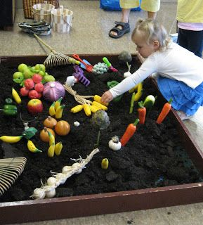 "What a great idea to let the kids ""plant"" and ""harvest"" pretend fruits and veggies. Great opportunity to talk about what grows on trees (I see bananas in the picture), bushes, in the ground. Maybe even use an old kids pool."