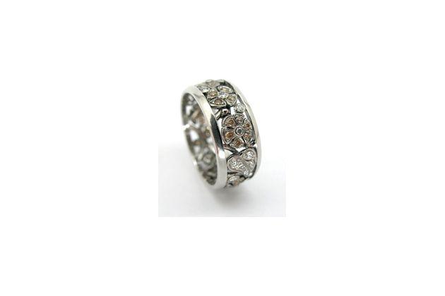 Platinum and diamond flower wedding ring