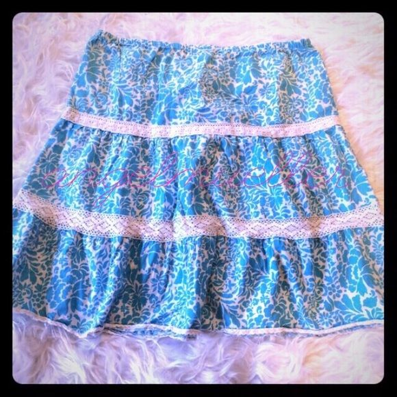 "Blue and white flowy skirt. Blue and white skirt with eyelet  lace accents. Elastic in the waist. Length: 21"" hips: 20"" waist: 16.25"". This item is used and may have imperfections. Few small spots not noticeable while wearing. Old Navy Skirts"