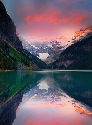 A late summer sunrise from Lake Louise in Banff National Park. Spectaculat atmosperhic clouds and a sunrise provide this amazing color. Lake Louise, Banff National Park, Alberta