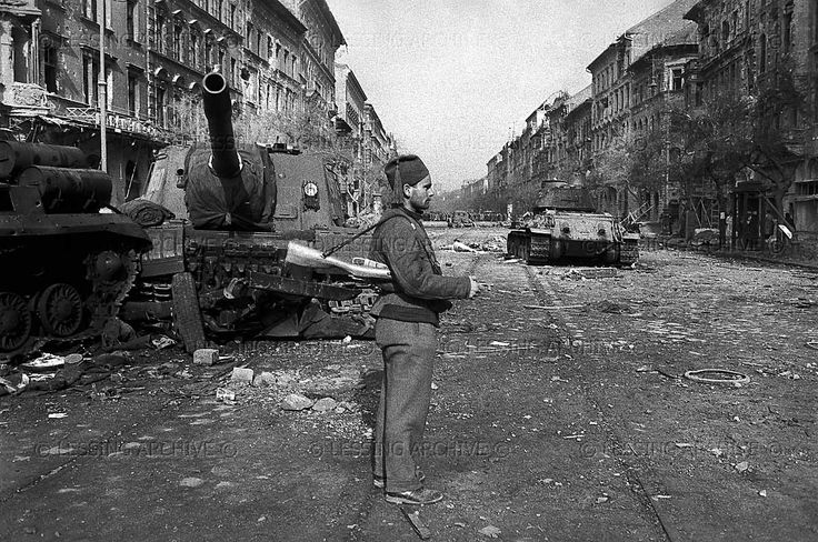 The Hungarian Revolution began with a first mass-rally in Budapest on October 23,1956. It was crushed by Soviet tanks and artillery after days of street-fighting. Destroyed Soviet tanks and artillery on Erzsebet Koerut in downtown Budapest, an insurgent member of the Hungarian Army. 1956. Erich Lessing photography