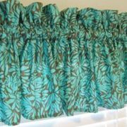 Making your own window treatments can save money and let you design a space that is truly you. A great way to start is with a valance -- a short curtain that can be hung over blinds or with other drapes. There are many types of valances and it's fun to play around once you have some practice. This tutorial is for a ruffled top, gathered...