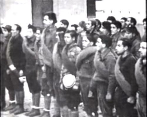 "hellyeahgeorgeorwell: ""George Orwell with other soldiers in Spain during the Spanish Civil War. "" (George Orwell is the frighteningly tall one sticking out in the front row)"