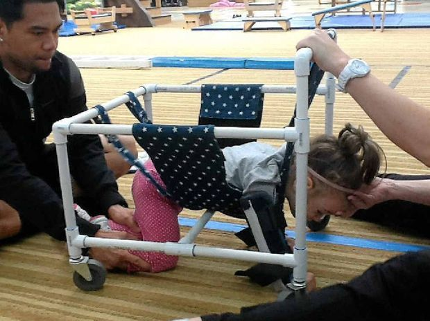 device to help get a child into the crawling position to put weight through limbs. Needs to be height adjustable and have a strap for head support. Here is an example of one I found online along ...