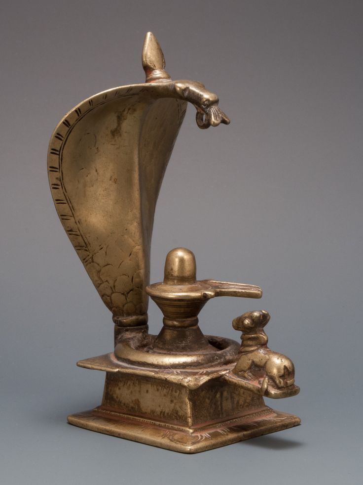 "Shiva Lingam-yoni covered above by the naga hood, Nandi the bull sits below. cast bronze/brass 4.75"" 17-18th C."