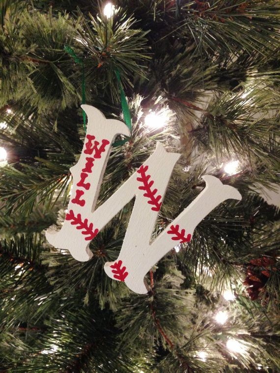 Your favorite baseball/softball player or fan will cheer for this hand-painted wooden ornament in red and white. Letters are about 3 inches tall and vary in width depending on the character. All letters, A to Z, are available. Placement of ribbon determined by letter. Size of personalization and placement of stitches dictated by length of name. With your order, PLEASE SPECIFY: • Ornament initial letter • Player/fans name, team name or other desired personalization • Year (painted on back)…
